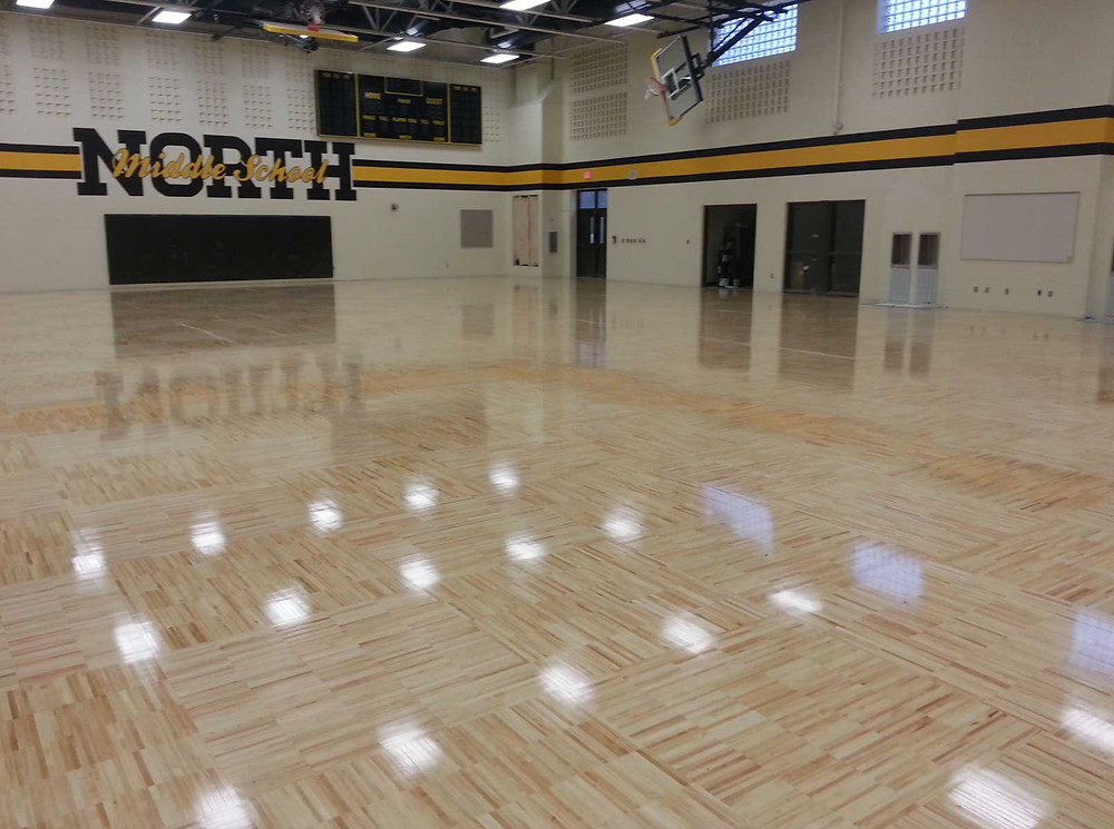 Lanse Creuse Middle School North located in Macomb, Michigan wood gymnasium flooring