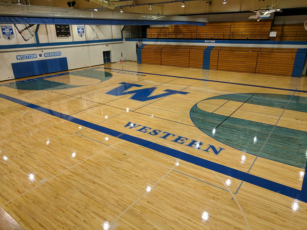 Walled Lake Western High School located in Commerce Charter Twp, Michigan wood gymnasium flooring