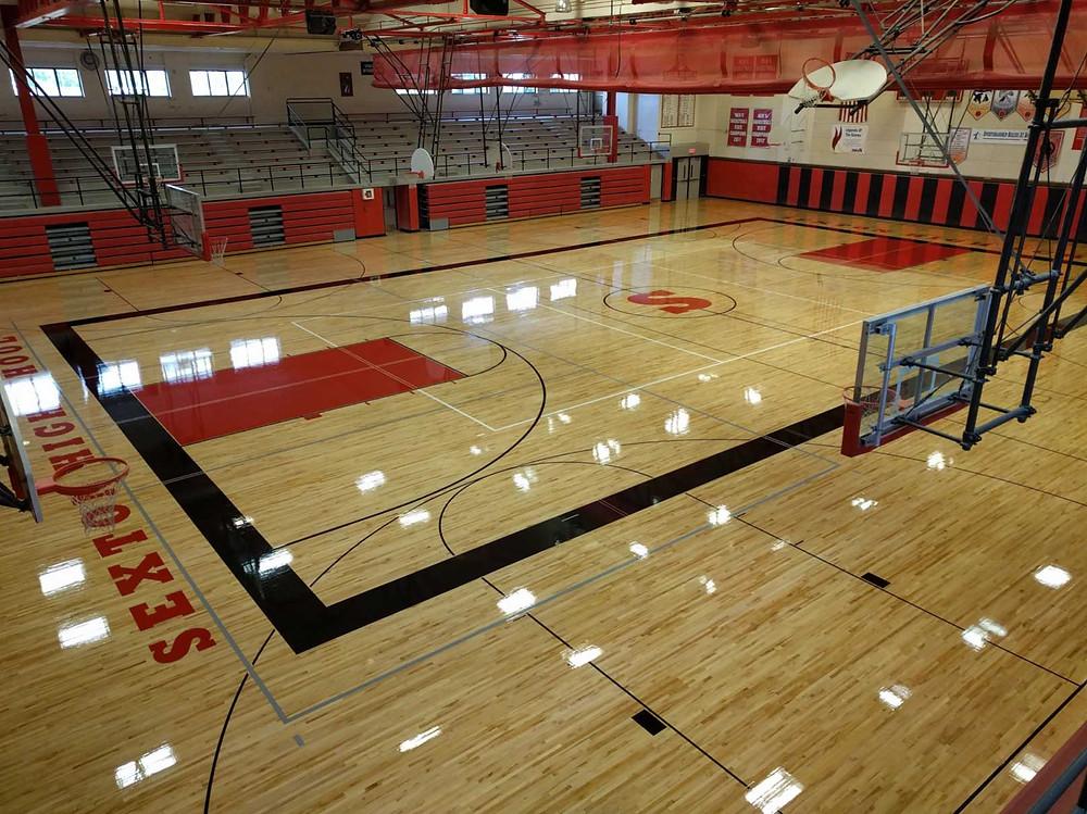 Sexton High School located in Lansing, Michigan Aacer wood gymnasium flooring