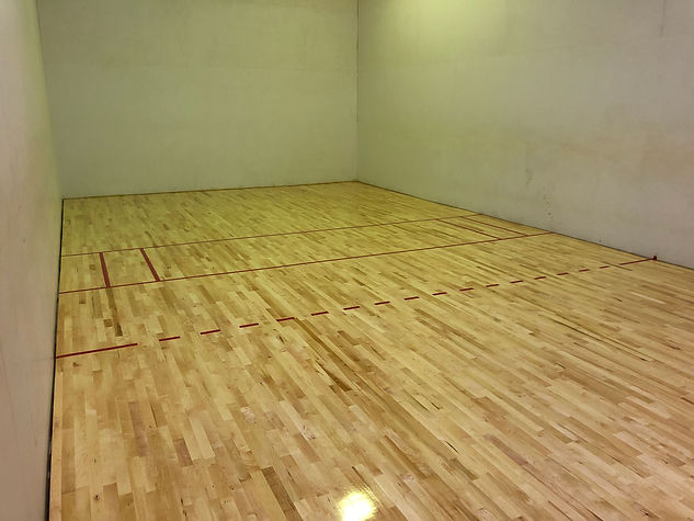 Racquetball court flooring is an anchored lock tight system placed by Foster Specialty Floors