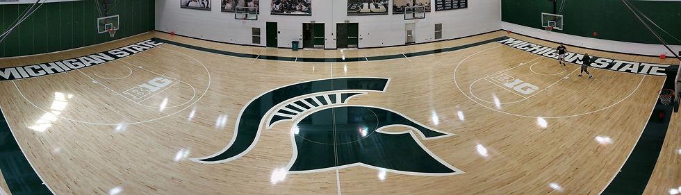 Robbins Permanent hardwood gymnasium flooring at Michigan State University. Spartan head logo Foster