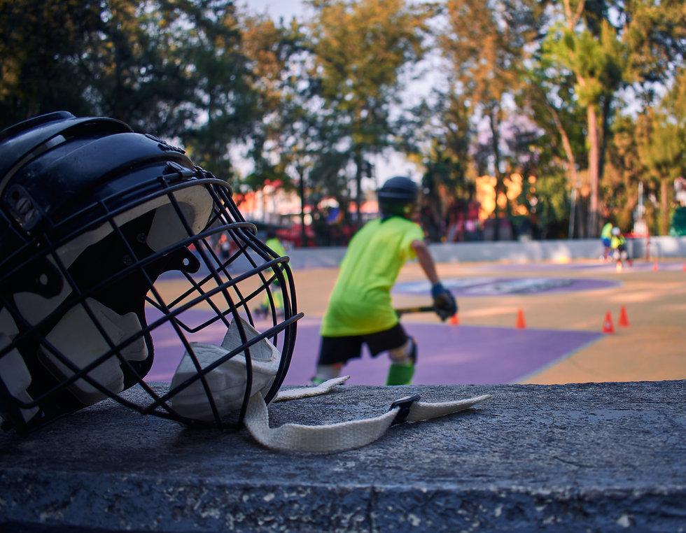 Black hockey helmet with black face on a