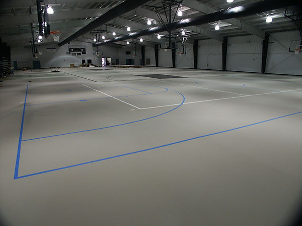 Seamless Synthetic multipurpose gymnasium flooring. Flooring placed by Foster Specialty Floors