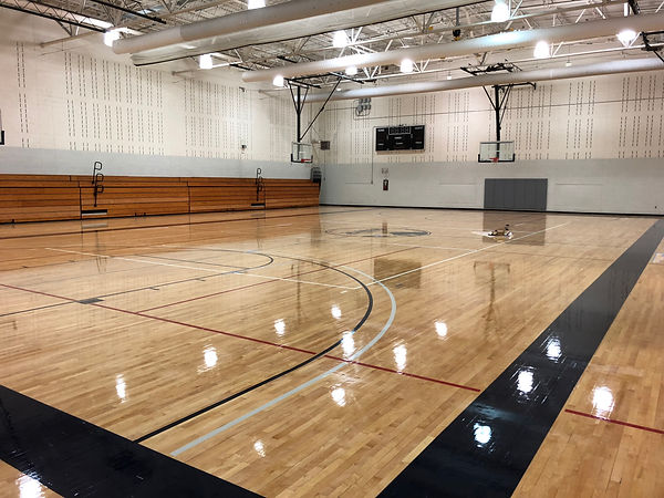 Wood gymnasium flooring placed by Foster Specialty Floors