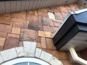 This is what happens to tile that is put on with mortar and inexperienced installation. It is DANGER