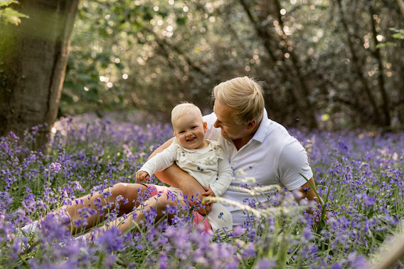 father and daughter, sitting in bluebells - stephanie atkins photography