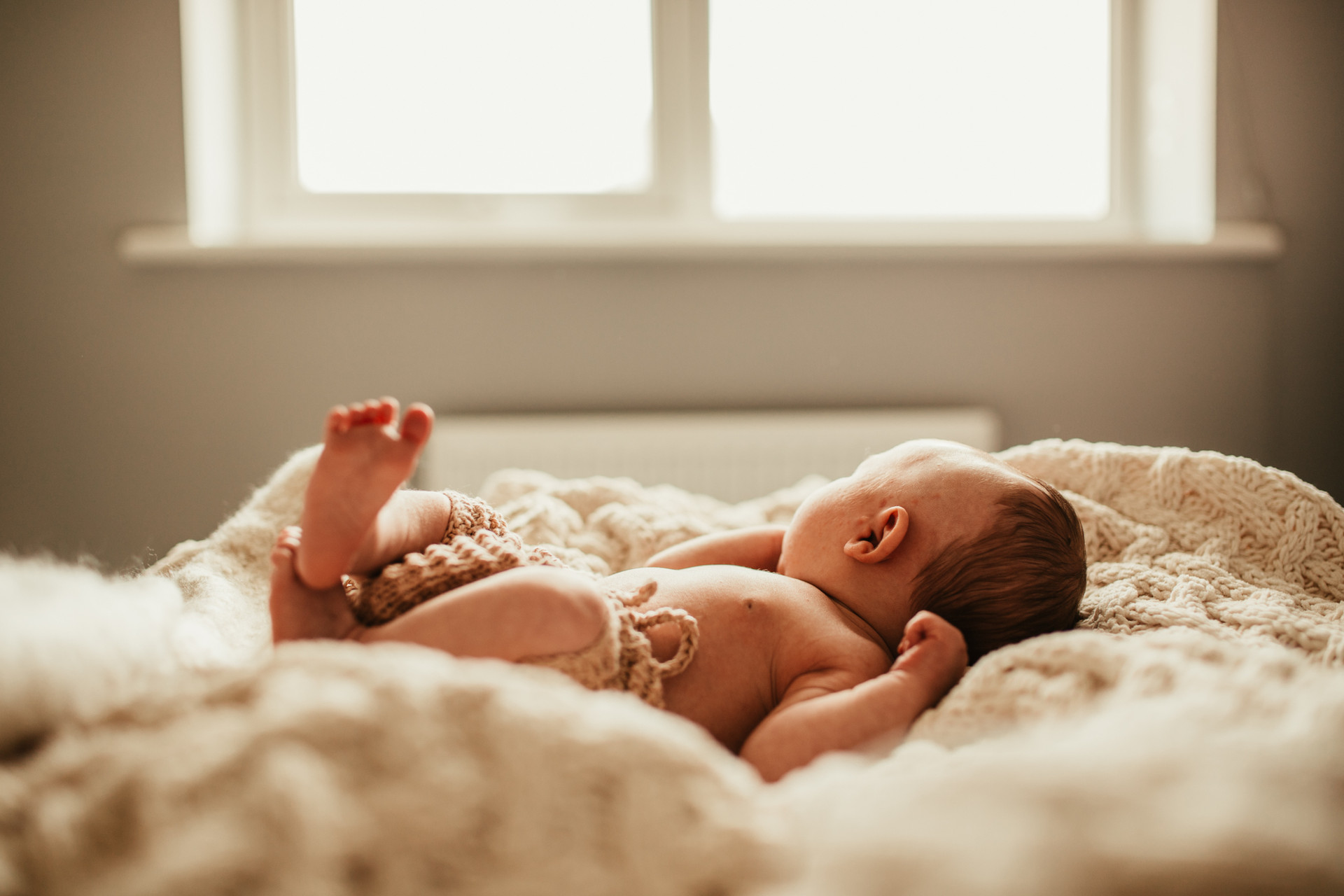 baby in the window light