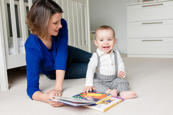 mum and son reading on the bedroom floor Stephanie Atkins Photography