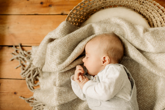 baby boy in moses basket