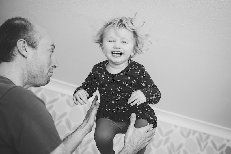 little girl thrown in the hair by father Stephanie Atkins Photography