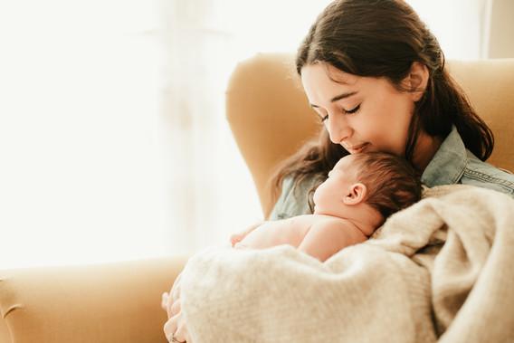 mum holds baby girl
