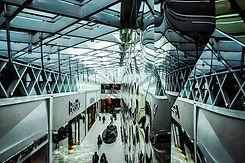 wide-angle-photo-of-gray-hallway-1441009