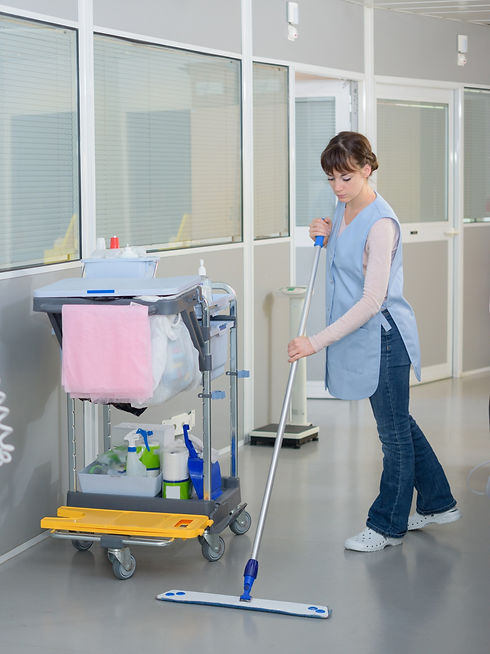 Woman cleaning floor in commercial building