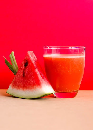 watermelon-shake-filled-glass-cup-beside