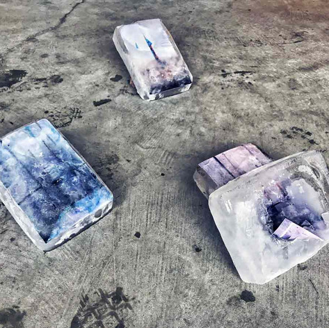 Liminal Transformations: Collected rain water frozen into a block and left to melt -returning the water back to where it came from.