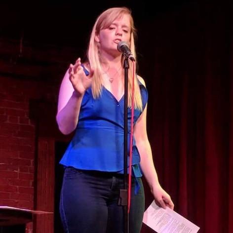 Kelsey Bigelow performing at the Ames Poetry Slam