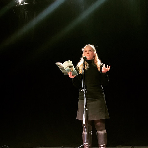 Kelsey Bigelow featuring at the Des Moines Poetry Slam