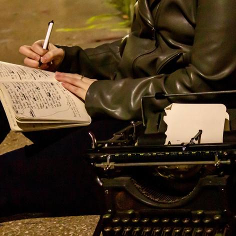 Kelsey Bigelow writing in notebook