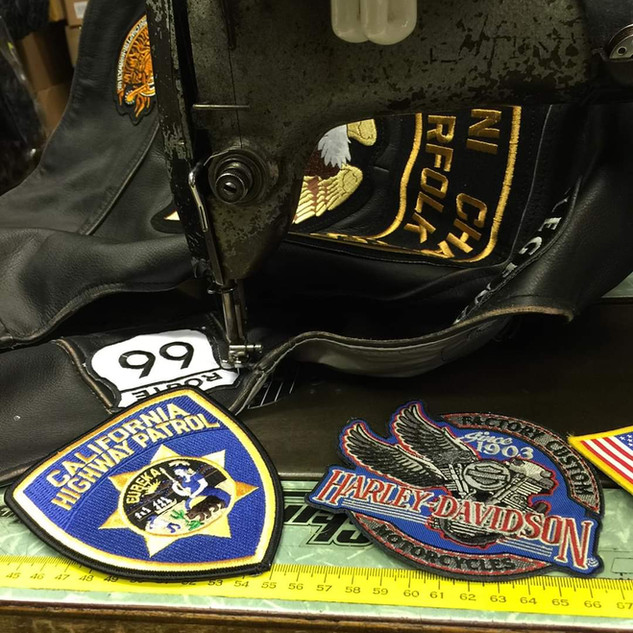 Badges and patches sewn.