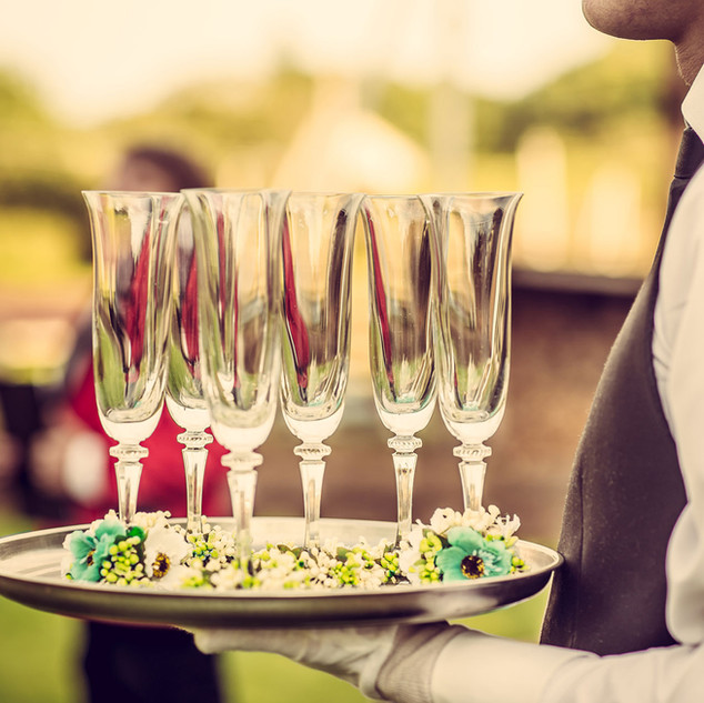 Waiter with Champagne Flutes