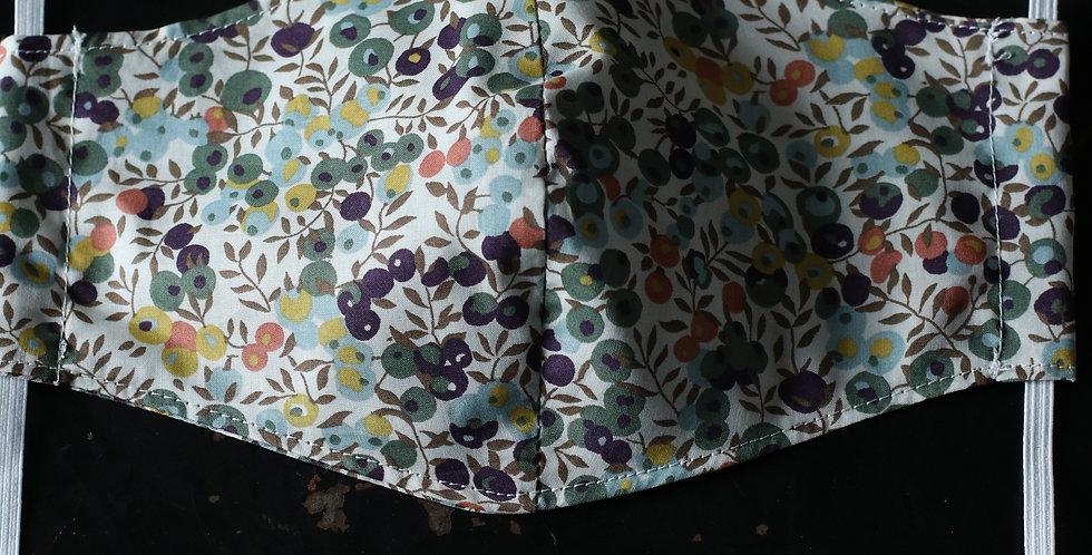 Munnbind sydd av Liberty tekstil