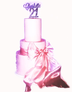 3 tier pink buttercream bow cake