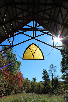 chapel stained glass sun .jpg