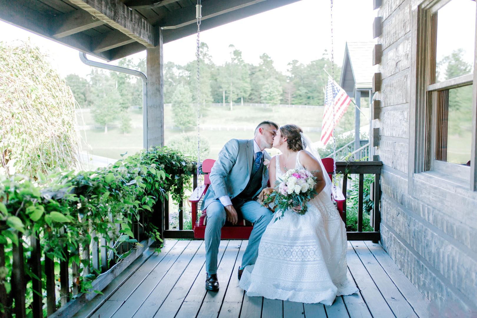 Bride & Groom porch swing kiss