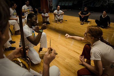 Andre S. and Ron Coleman in a roda during the Roanoke Capoeira Center grand opening. Capoeira Angola Quintal.
