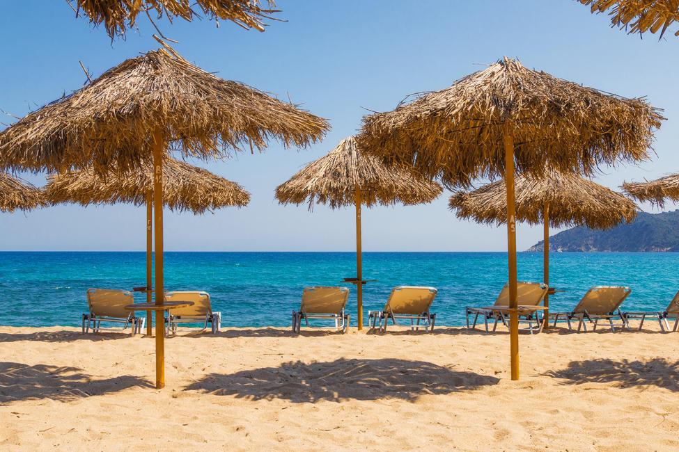 Cocktail umbrellas at Mandraki Beach.jpg