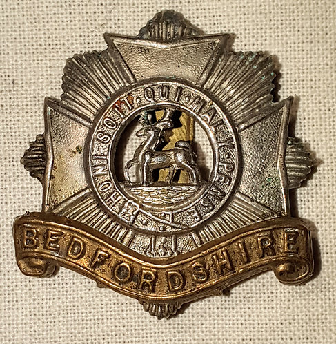 Original Bedfordshire Regiment cap badge (repaired)
