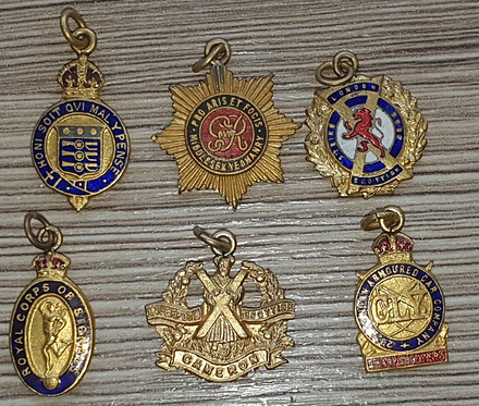 Selection of small cap badges of WW2 possibly fobs badges.
