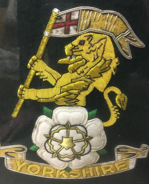 A large Clothe Embroidered Yorkshire Regiment Framed Badge