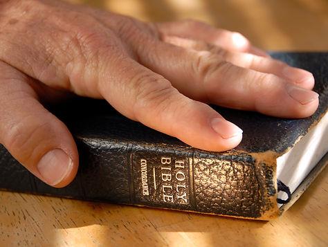 Left Hand On Bible For Testimonial Oath,