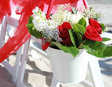 metal pail with red roses and hydrangea