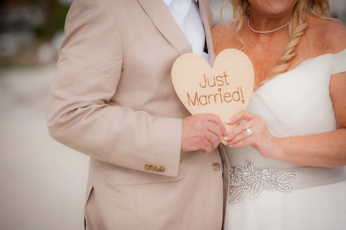 coronado beach wedding with just married sign