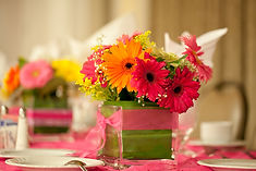 square centerpiece with gerbera daisies