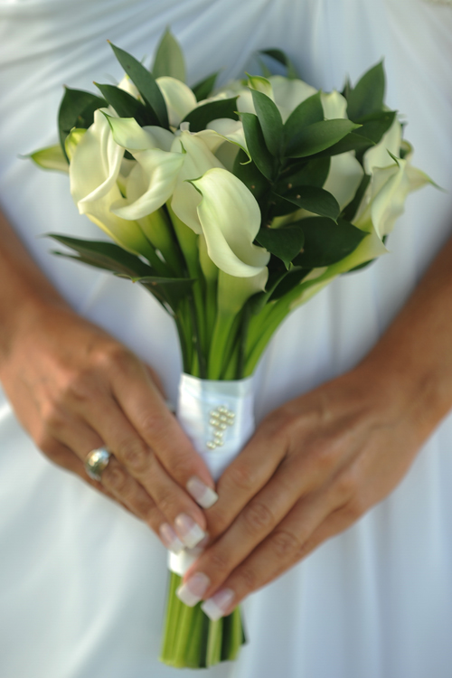"White Mini Calla (""real touch"" flowers may be used in this design)"