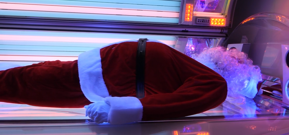 santa on sunbed.PNG