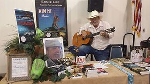 Ernie at book show w guitar.jpeg