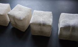 Four White Cubes, Nine Indigo Squares