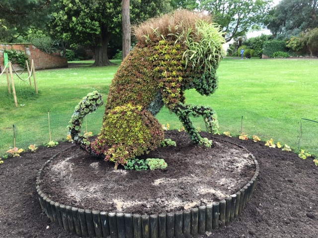 The Lion is finished. Now the bedding.  Come and see his prairie garden
