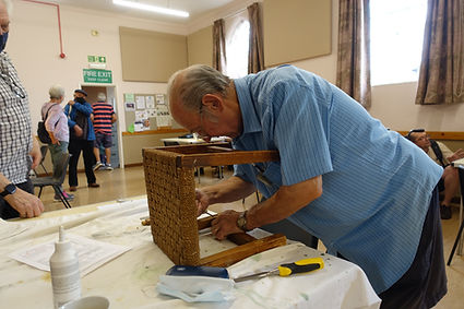 Small wooden stool being repaired at the kenilworth repair cafe
