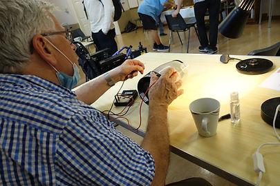 Repairing an electrical lamp at the Kenilworth Repair Cafe