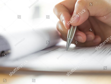 stock-photo-hand-with-pen-over-applicati