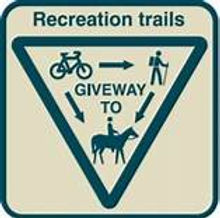 Recreation trails give way sign, give way to cyclists, walkers and horse riders