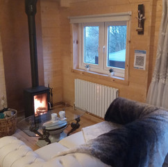 Swan Lodge sitting area with log burner