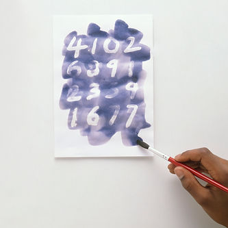 child-using-paintbrush-and-blue-ink-to-m