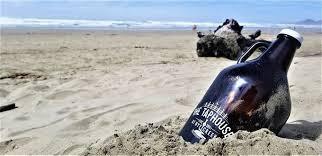 taphouse grumbler on beach.jpg