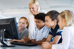 kids-in-computer-class-with-teacher-P5Q6